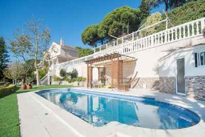 Villa with a sea view and two swimming pools close to Barcelona